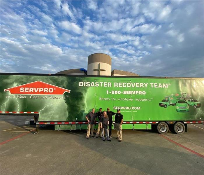 SERVPRO Employees standing in front of a truck